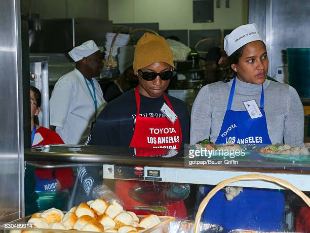 Pharrell Williams and Helen Lasichanh are seen at LA Mission Christmas Dinner for the Homeless on December 23 2016 in Los Angeles California
