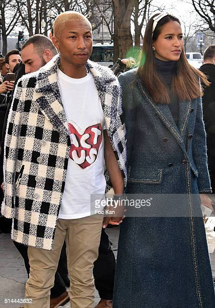 Pharrell Williams and Helen Lasichanh arrive at the Chanel show as part of the Paris Fashion Week Womenswear Fall/Winter 2016/2017 on March 8 2016 in...