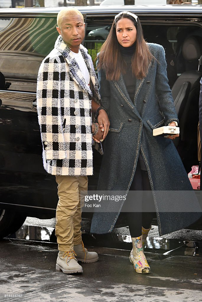 Pharrell Williams and Helen Lasichanh arrive at the Chanel show as part of the Paris Fashion Week Womenswear Fall/Winter 2016/2017 on March 8, 2016 in Paris, France.