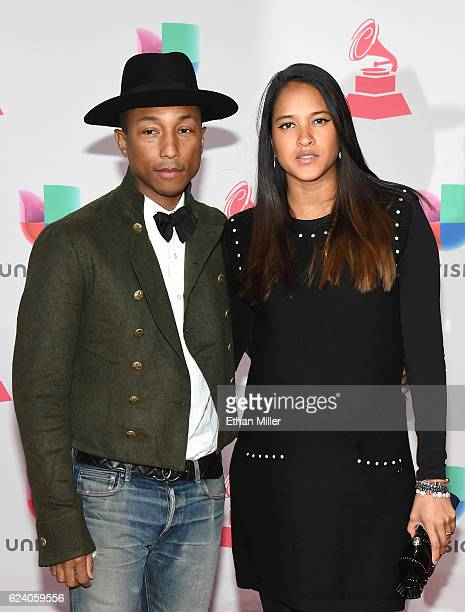 Pharrell Williams and Helen Lasichanh attend The 17th Annual Latin Grammy Awards at TMobile Arena on November 17 2016 in Las Vegas Nevada
