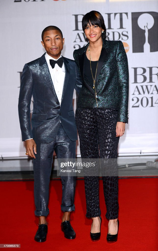Pharrell Williams and Helen Lasichanh attend The BRIT Awards 2014 at 02 Arena on February 19, 2014 in London, England.