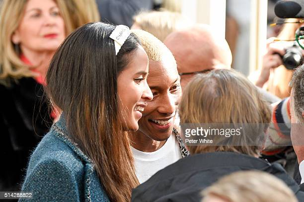 Pharrell Williams and Helen Lasichanh attend the Chanel show as part of the Paris Fashion Week Womenswear Fall/Winter 2016/2017 on March 8 2016 in...