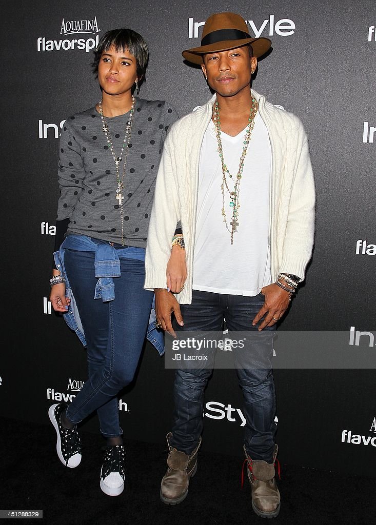 <a gi-track='captionPersonalityLinkClicked' href=/galleries/search?phrase=Pharrell+Williams&family=editorial&specificpeople=161396 ng-click='$event.stopPropagation()'>Pharrell Williams</a> and Helen Lasichanh attend the Hollywood Foreign Press Association (HFPA) And InStyle 2014 Miss Golden Globe Announcement / Celebration at Fig & Olive Melrose Place on November 21, 2013 in West Hollywood, California.