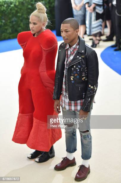 Pharrell Williams and Helen Lasichanh attend the 'Rei Kawakubo/Comme des Garcons Art Of The InBetween' Costume Institute Gala at Metropolitan Museum...