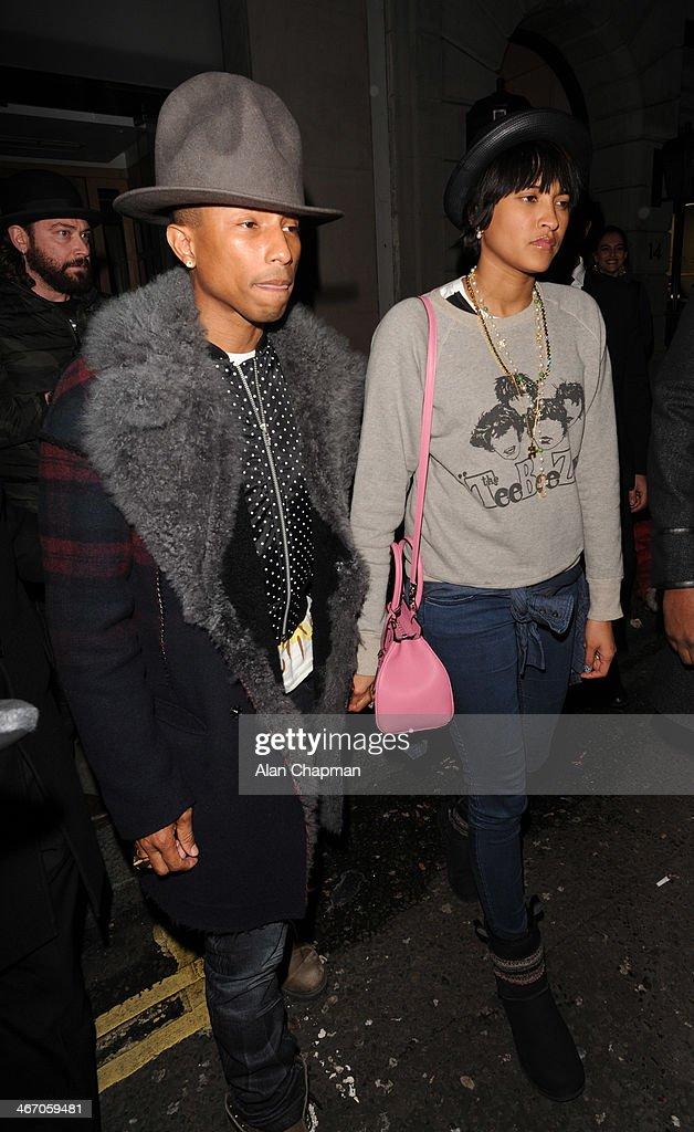 Pharrell Williams and Helen Lasichanh seen leaving Nobu Restaurant Berkeley Street on February 5, 2014 in London, England.