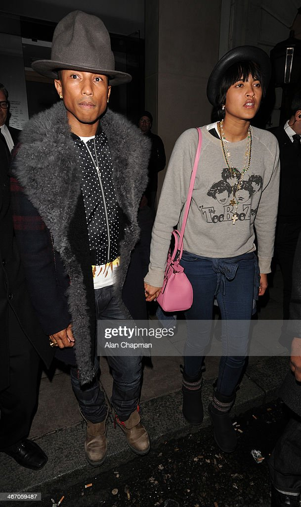 Pharrell Williams and Helen Lasichanh seen leaving Nobu Restaurant Berkeley Street on February 5, 2014 in London, England.