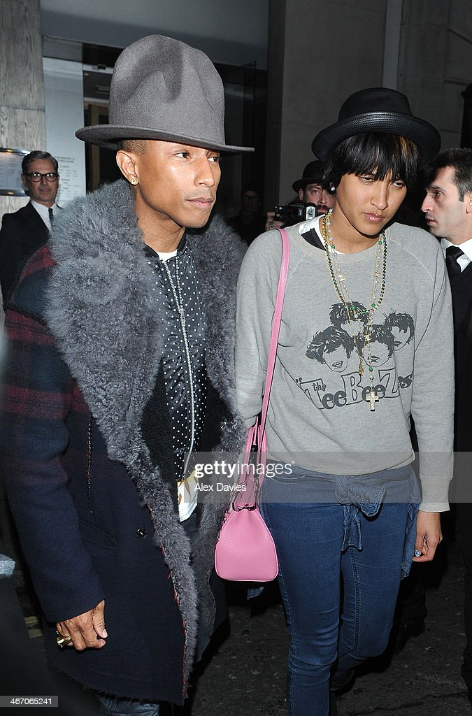 <a gi-track='captionPersonalityLinkClicked' href=/galleries/search?phrase=Pharrell+Williams&family=editorial&specificpeople=161396 ng-click='$event.stopPropagation()'>Pharrell Williams</a> and <a gi-track='captionPersonalityLinkClicked' href=/galleries/search?phrase=Helen+Lasichanh&family=editorial&specificpeople=9633714 ng-click='$event.stopPropagation()'>Helen Lasichanh</a> sighting leaving Nobu Restaurant on February 5, 2014 in London, England.