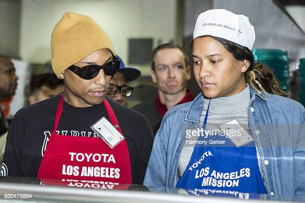 Pharrell Williams and Helen Lasichanh Williams attend the Los Angeles Mission Christmas Celebration on December 23 2016 in Los Angeles California