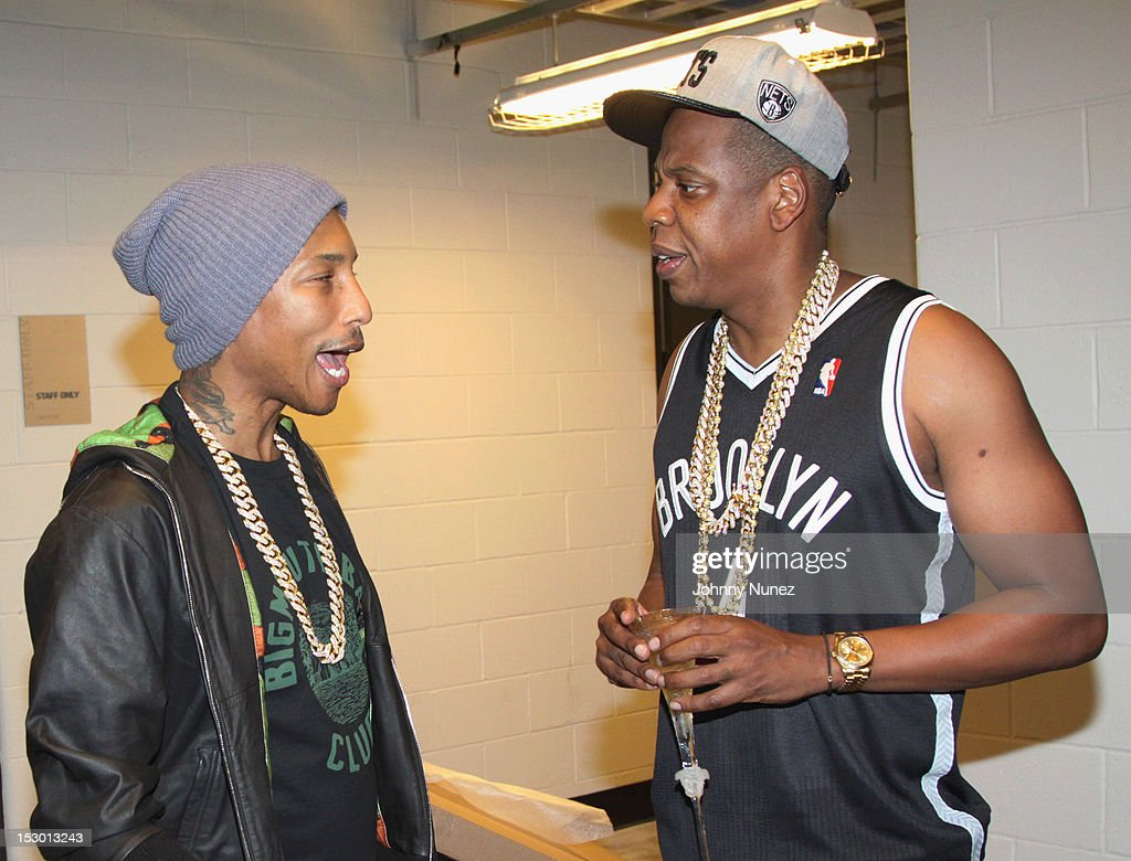 <a gi-track='captionPersonalityLinkClicked' href=/galleries/search?phrase=Pharrell+Williams&family=editorial&specificpeople=161396 ng-click='$event.stopPropagation()'>Pharrell Williams</a> and <a gi-track='captionPersonalityLinkClicked' href=/galleries/search?phrase=Jay-Z&family=editorial&specificpeople=201664 ng-click='$event.stopPropagation()'>Jay-Z</a> backstage at the The exclusive D'USSE VIP Lounge at Barclays Center on September 28, 2012 in New York City.