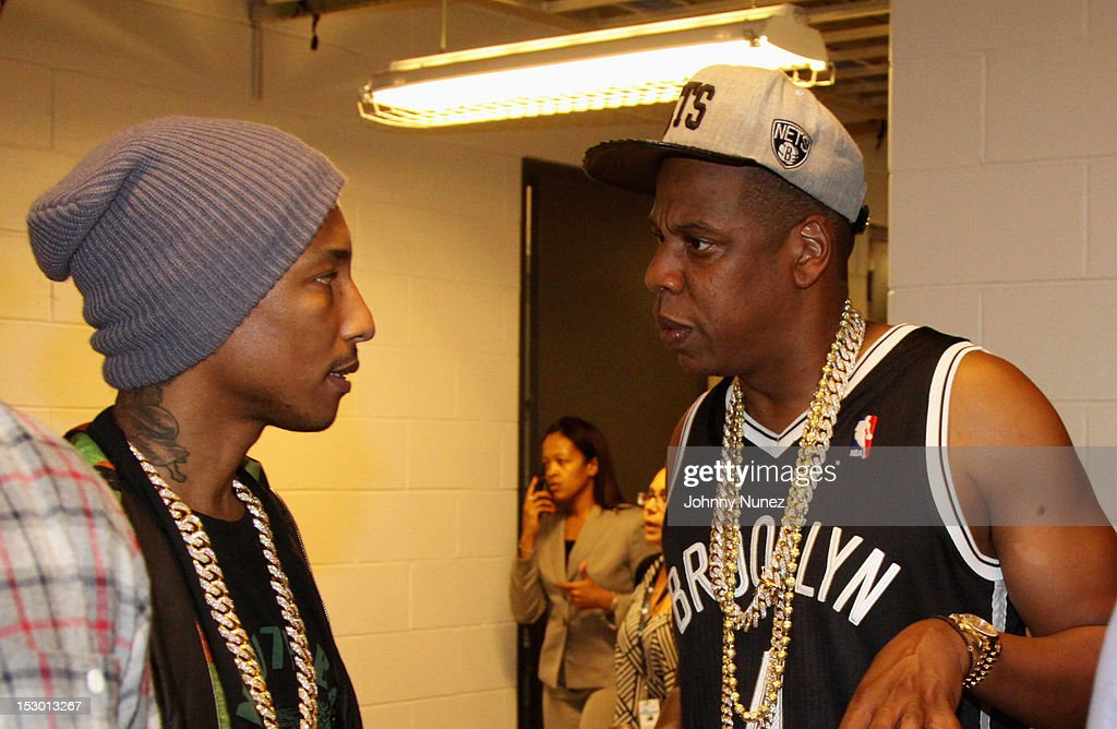 <a gi-track='captionPersonalityLinkClicked' href=/galleries/search?phrase=Pharrell+Williams&family=editorial&specificpeople=161396 ng-click='$event.stopPropagation()'>Pharrell Williams</a> and <a gi-track='captionPersonalityLinkClicked' href=/galleries/search?phrase=Jay-Z&family=editorial&specificpeople=201664 ng-click='$event.stopPropagation()'>Jay-Z</a> chat backstage at the the exclusive D'USSE VIP Lounge at Barclays Center on September 28, 2012 in New York City.