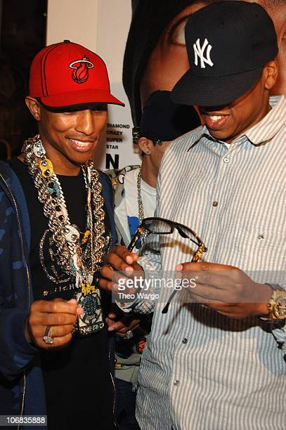 Pharrell Williams and JayZ during Louis Vuitton and Interview Magazine Host Party for Nigo Interview Magazine Cover at Louis Vuitton Soho in New York...