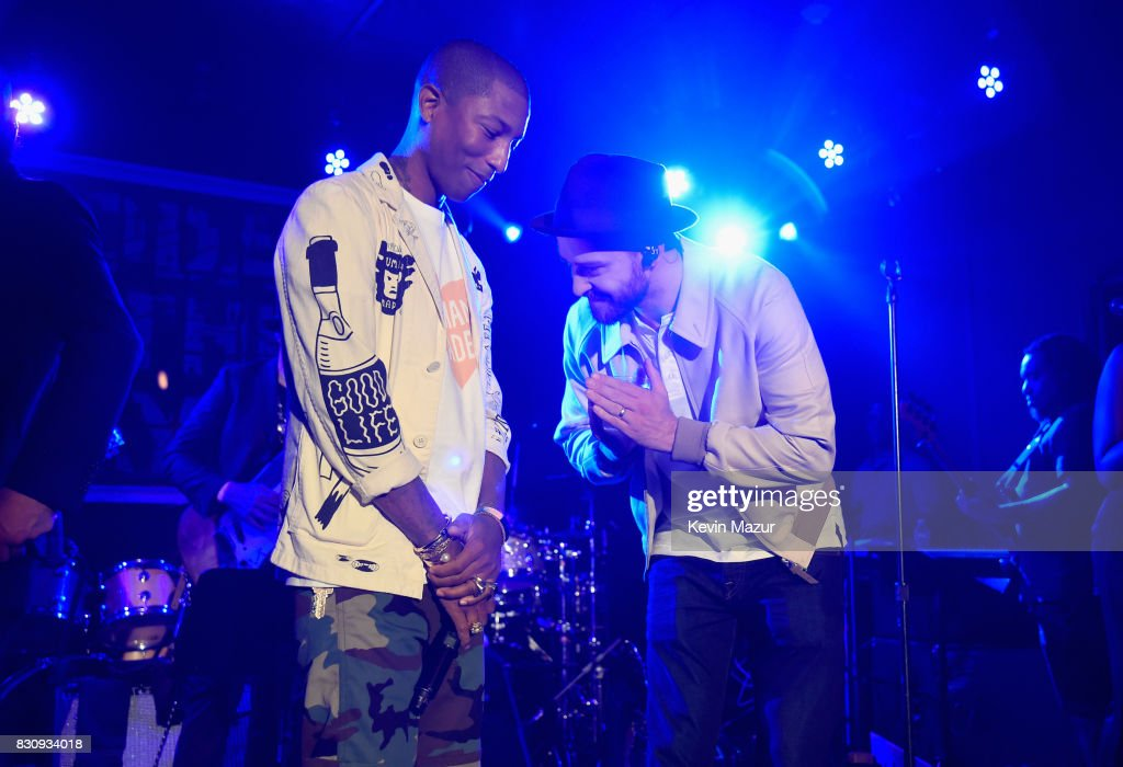 Pharrell Williams and Justin Timberlake perform onstage at Apollo in the Hamptons 2017: hosted by Ronald O. Perelman at The Creeks on August 12, 2017 in East Hampton, New York.