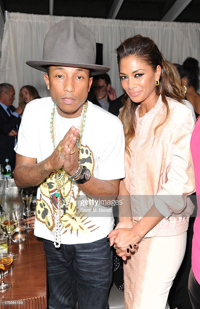 Pharrell Williams and Nicole Scherzinger attend The BRIT Awards 2014 Sony after party on February 19, 2014 in London, England.