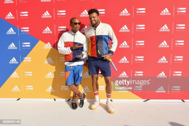 Pharrell Williams and professional tennis player JoWilfried Tsonga attend adidas Tennis Pharrell Williams Don't Be Quiet Please Event at Frederick...