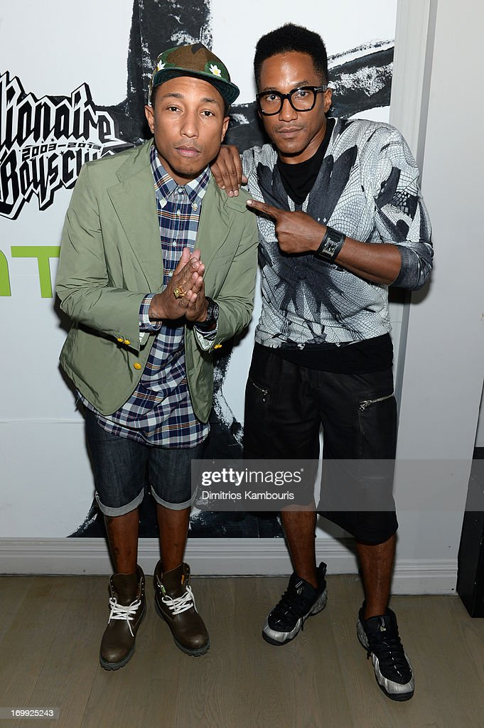 Pharrell Williams and Q-Tip attend the 10th anniversary party of Billionaire Boys Club presented by HTC at Tribeca Canvas on June 4, 2013 in New York City.