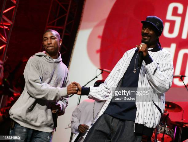 Pharrell Williams and Snoop Dogg during KIIS FM 'Jingle Ball' Concert 2004 at Arrowhead Pond in Anaheim California United States