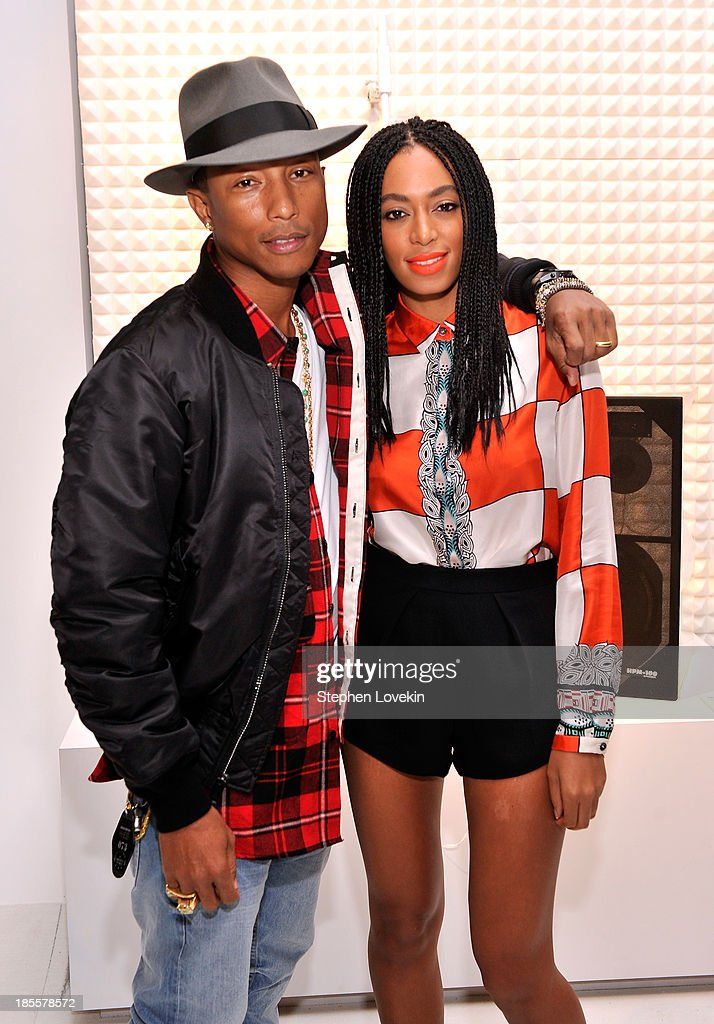 Pharrell Williams and Solange Knowles attend eBays launch of new features during its Future of Shopping event at Industria Studios on October 22, 2013 in New York City.