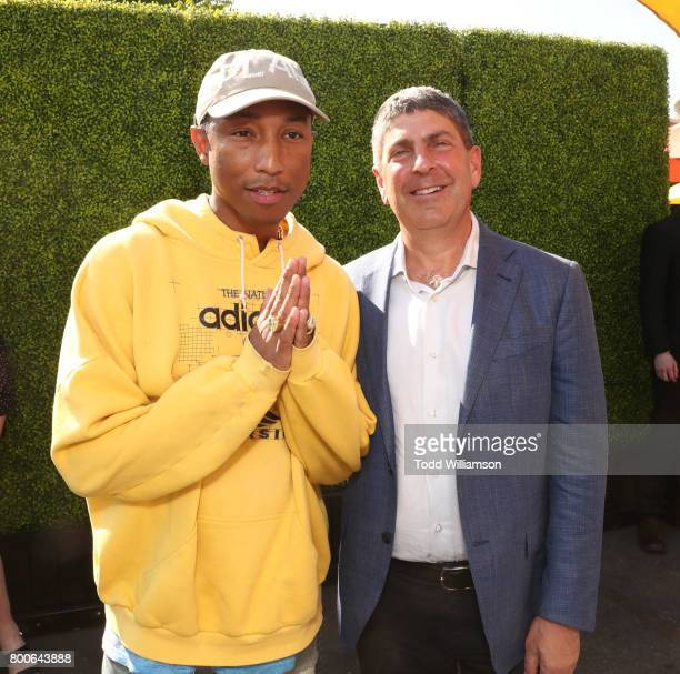Pharrell Williams and Universal Filmed Ent Chairman Jeff Shell attend the Premiere Of Universal Pictures And Illumination Entertainment's 'Despicable...