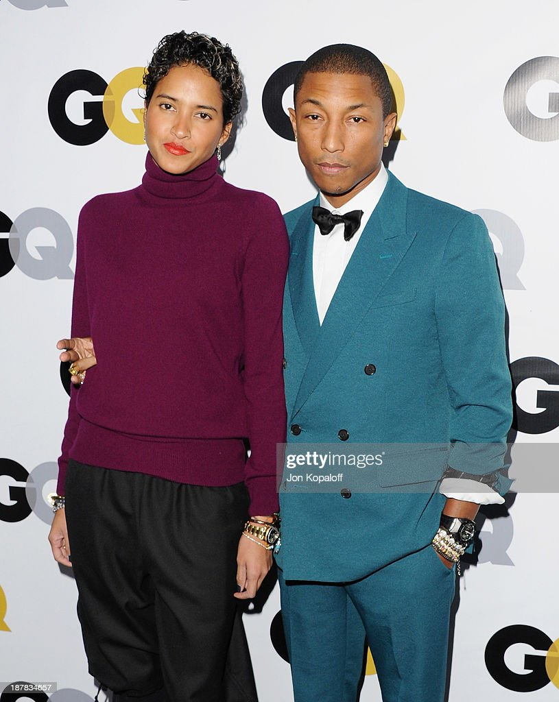 <a gi-track='captionPersonalityLinkClicked' href=/galleries/search?phrase=Pharrell+Williams&family=editorial&specificpeople=161396 ng-click='$event.stopPropagation()'>Pharrell Williams</a> and wife Helen Lasichanh arrive at GQ Celebrates The 2013 'Men Of The Year' at The Wilshire Ebell Theatre on November 12, 2013 in Los Angeles, California.
