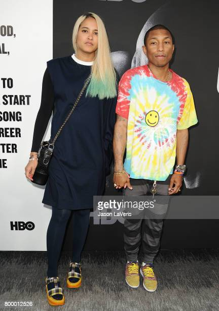 Pharrell Williams and wife Helen Lasichanh attend the premiere of 'The Defiant Ones' at Paramount Theatre on June 22 2017 in Hollywood California