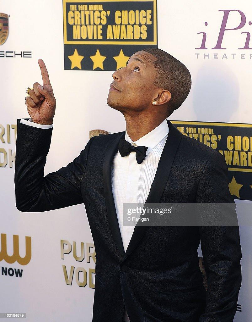 Pharrell Williams arrives at the 19th Annual Critics' Choice Movie Awards at Barker Hangar on January 16, 2014 in Santa Monica, California.