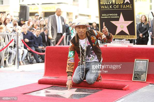 Pharrell Williams attends the ceremony honoring him with a Star on The Hollywood Walk of Fame on December 4 2014 in Hollywood California