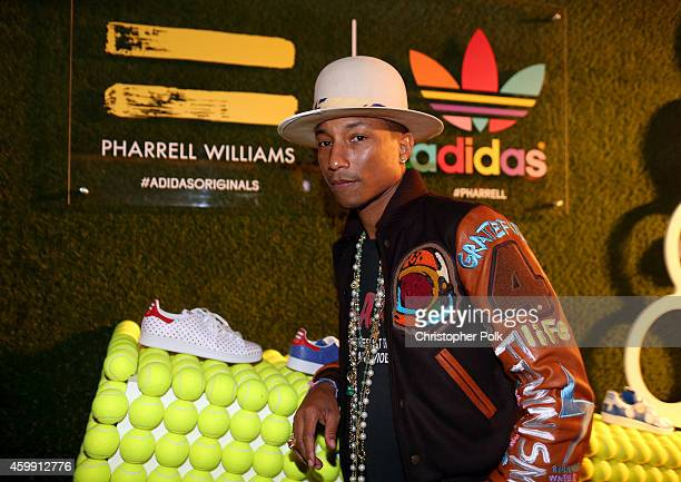 Pharrell Williams attends the collaboration celebration of Pharrell Williams and Adidas at Hinoki The Bird on December 3 2014 in Los Angeles...