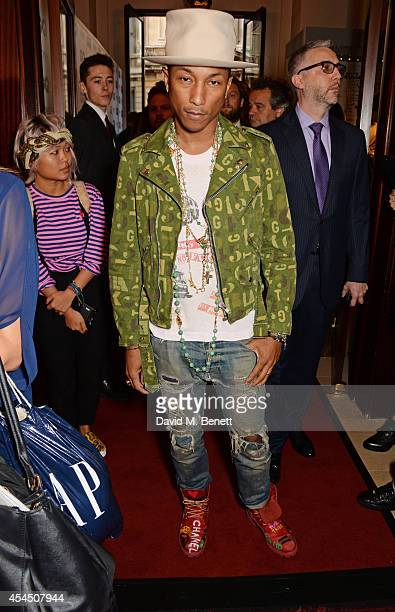 Pharrell Williams attends the GQ Men Of The Year awards in association with Hugo Boss at The Royal Opera House on September 2 2014 in London England