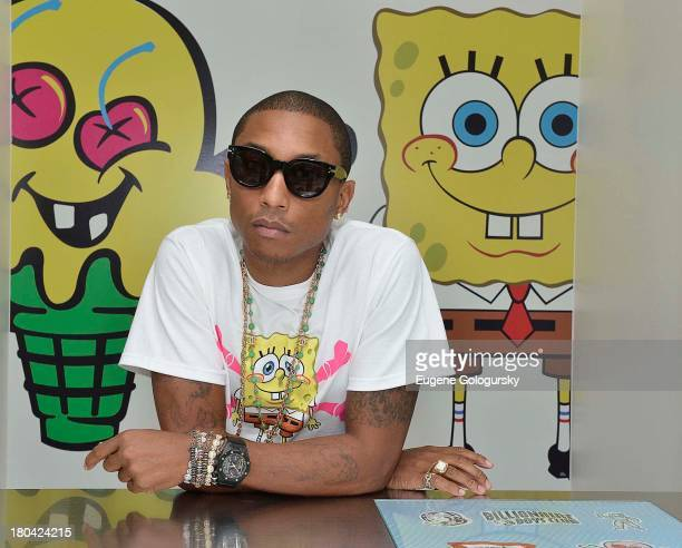 Pharrell Williams attends the Nickelodeon And Pharrell Williams Debut SpongeBob X ICECREAM Capsule Collection on September 10 2013 in New York City