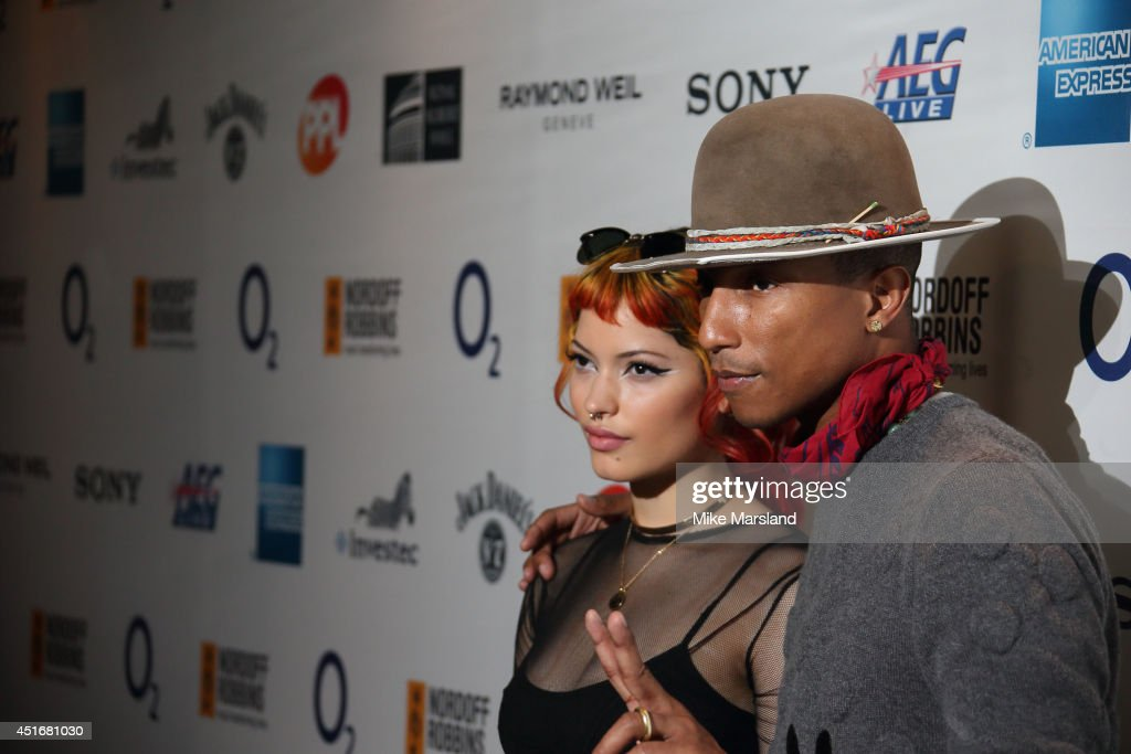 <a gi-track='captionPersonalityLinkClicked' href=/galleries/search?phrase=Pharrell+Williams&family=editorial&specificpeople=161396 ng-click='$event.stopPropagation()'>Pharrell Williams</a> attends the Nordoff Robbins 02 Silver Clef awards at London Hilton on July 4, 2014 in London, England.