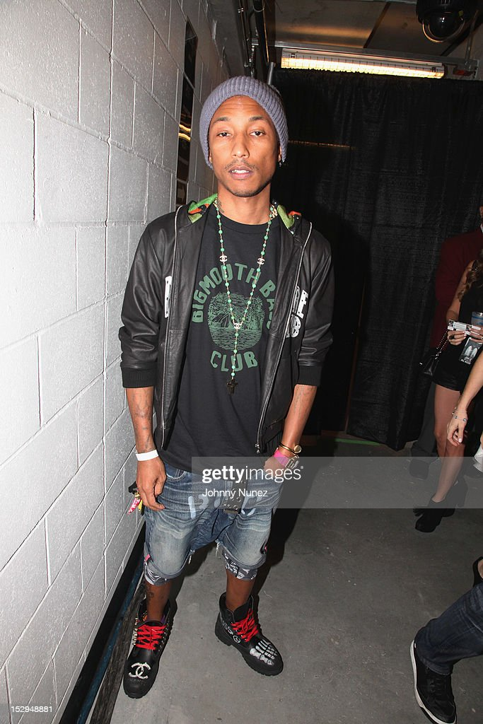 <a gi-track='captionPersonalityLinkClicked' href=/galleries/search?phrase=Pharrell+Williams&family=editorial&specificpeople=161396 ng-click='$event.stopPropagation()'>Pharrell Williams</a> backstage at the exclusive D'USSE VIP Lounge at Barclays Center on September 28, 2012 in New York City.