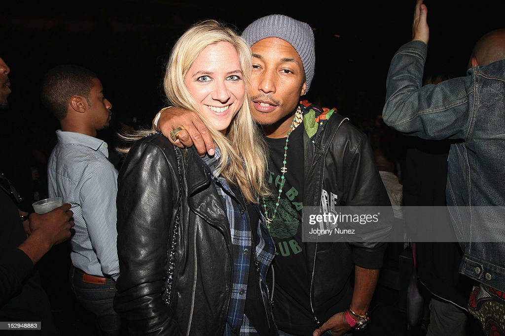 <a gi-track='captionPersonalityLinkClicked' href=/galleries/search?phrase=Pharrell+Williams&family=editorial&specificpeople=161396 ng-click='$event.stopPropagation()'>Pharrell Williams</a> (R) backstage at the exclusive D'USSE VIP Lounge at Barclays Center on September 28, 2012 in New York City.