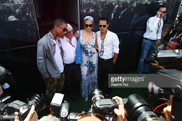 Pharrell Williams Bernie Ecclestone Jennifer Lopez and her husband Marc Anthony are seen in the paddock during the Monaco Formula One Grand Prix at...