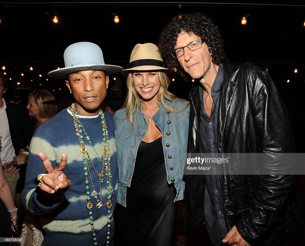 <a gi-track='captionPersonalityLinkClicked' href=/galleries/search?phrase=Pharrell+Williams&family=editorial&specificpeople=161396 ng-click='$event.stopPropagation()'>Pharrell Williams</a>, Beth Stern and Howard Stern attend Apollo in the Hamptons at The Creeks on August 16, 2014 in East Hampton, New York.