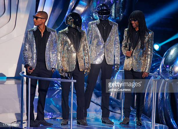 Pharrell Williams Daft Punk and Nile Rodgers speak onstage during the 2013 MTV Video Music Awards at the Barclays Center on August 25 2013 in the...