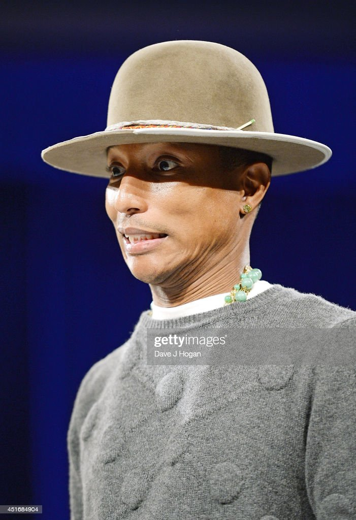 <a gi-track='captionPersonalityLinkClicked' href=/galleries/search?phrase=Pharrell+Williams&family=editorial&specificpeople=161396 ng-click='$event.stopPropagation()'>Pharrell Williams</a> during the Nordoff Robbins 02 Silver Clef awards at London Hilton on July 4, 2014 in London, England.