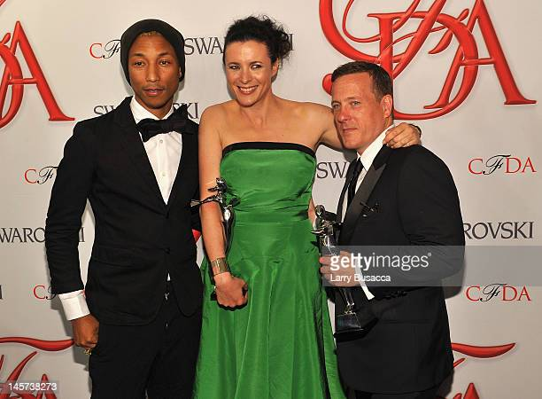 Pharrell Williams Garance Dore and Scott Schuman attend the 2012 CFDA Fashion Awards at Alice Tully Hall on June 4 2012 in New York City