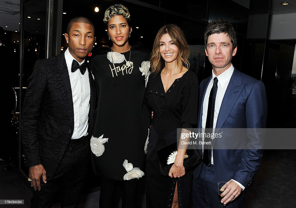 Pharrell Williams, guest, Sara Macdonald and Noel Gallagher arrive at the GQ Men of the Year awards at The Royal Opera House on September 3, 2013 in London, England.