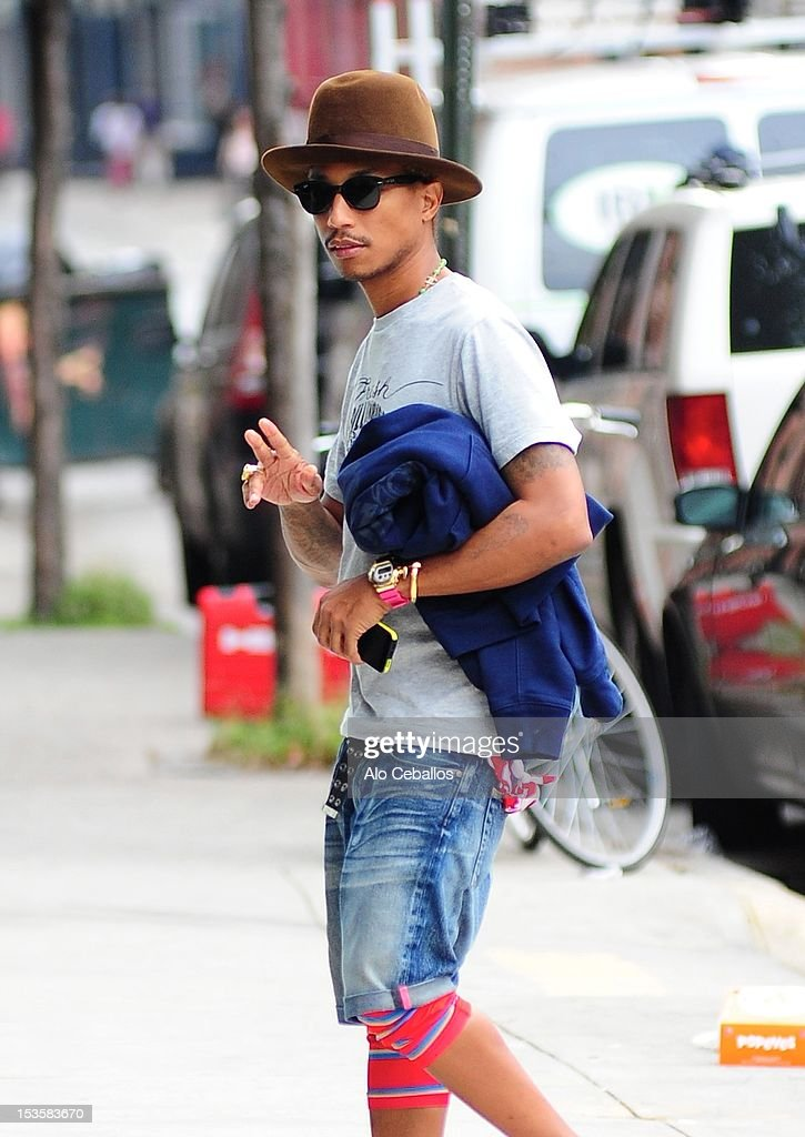 <a gi-track='captionPersonalityLinkClicked' href=/galleries/search?phrase=Pharrell+Williams&family=editorial&specificpeople=161396 ng-click='$event.stopPropagation()'>Pharrell Williams</a> is seen in the Meat Packing District at Streets of Manhattan on October 6, 2012 in New York City.