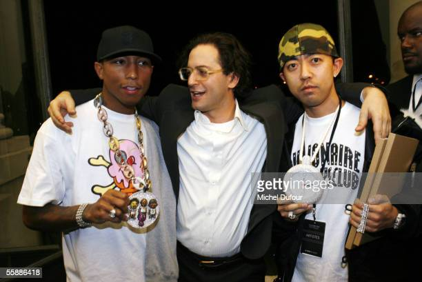 Pharrell Williams Marc Jacobs and Bathing Ape designer Nigo are seen backstage at the Louis Vuitton show during Paris Fashion Week Spring/Summer 2006...
