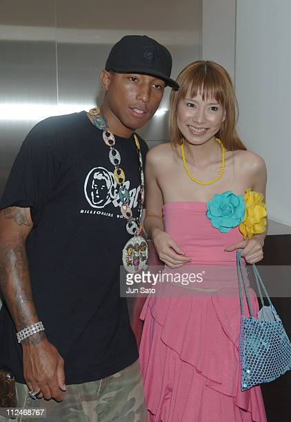 Pharrell Williams of N*E*R*D with Sakura Uehara during BAPE CAFE Reception and Opening Party at Bape Cafe in Tokyo Japan