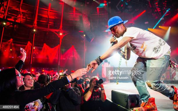 Pharrell Williams performs on stage for iTunes Festival at The Roundhouse on September 10 2014 in London United Kingdom