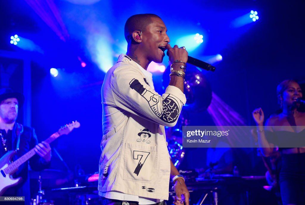 Pharrell Williams performs onstage at Apollo in the Hamptons 2017: hosted by Ronald O. Perelman at The Creeks on August 12, 2017 in East Hampton, New York.