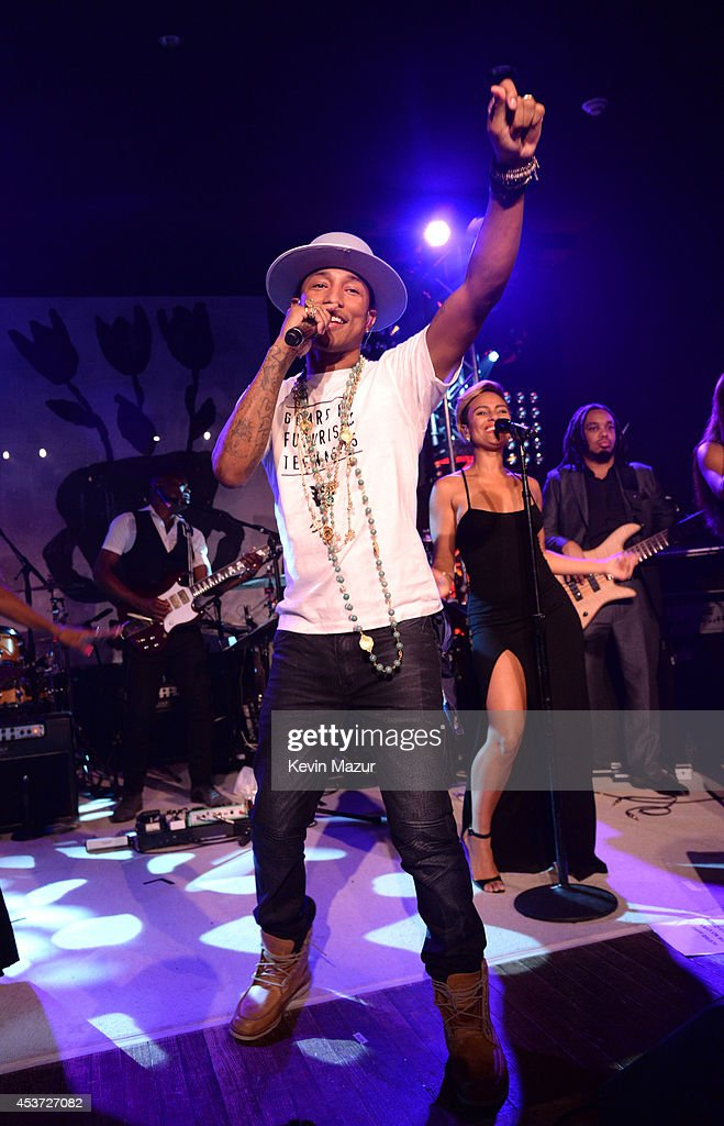 <a gi-track='captionPersonalityLinkClicked' href=/galleries/search?phrase=Pharrell+Williams&family=editorial&specificpeople=161396 ng-click='$event.stopPropagation()'>Pharrell Williams</a> performs onstage at Apollo in the Hamptons at The Creeks on August 16, 2014 in East Hampton, New York.