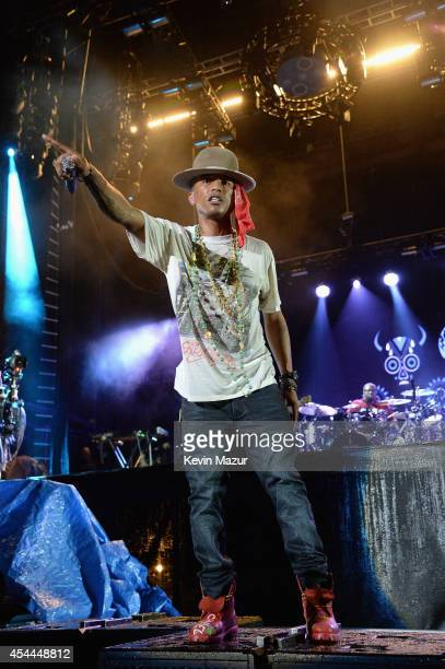 Pharrell Williams performs onstage at the 2014 Budweiser Made In America Festival at Benjamin Franklin Parkway on August 30 2014 in Philadelphia...