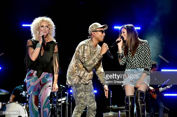 Pharrell Williams performs onstage with Kimberly Schlapman and Karen Fairchild of Little Big Town during 2016 CMA Festival Day 4 at Nissan Stadium on...
