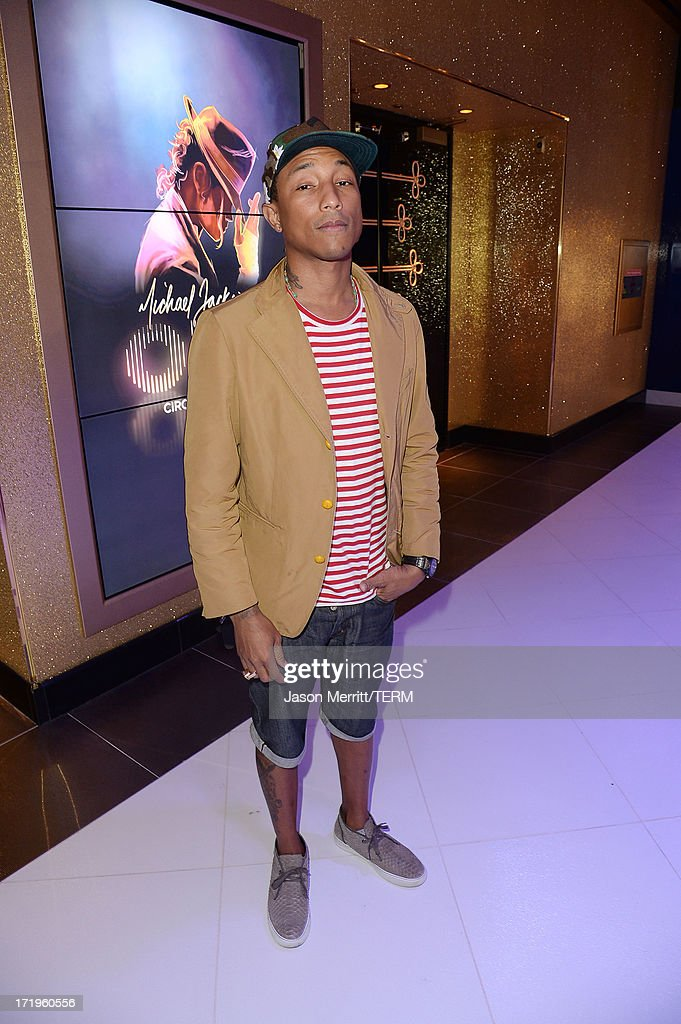 <a gi-track='captionPersonalityLinkClicked' href=/galleries/search?phrase=Pharrell+Williams&family=editorial&specificpeople=161396 ng-click='$event.stopPropagation()'>Pharrell Williams</a> poses at the world premiere of 'Michael Jackson ONE by Cirque du Soleil' at THEhotel at Mandalay Bay on June 29, 2013 in Las Vegas, Nevada.