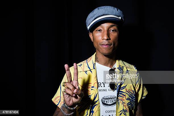 Pharrell Williams poses backstage as iHeartMedia hosts the main stage fireside chat about creativity with radio and television host and producer Ryan...