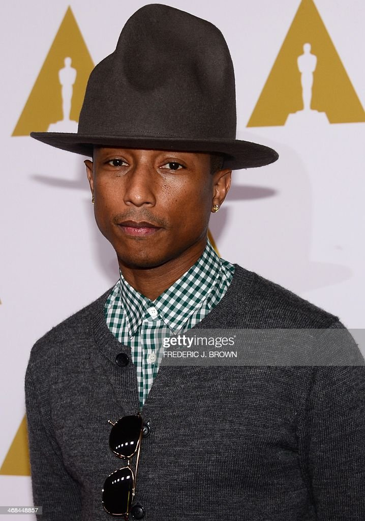 Pharrell Williams poses on arrival for the 86th Oscar's Nominee's Luncheon at the Beverly Hilton Hotel in Beverly Hills California on February 10...