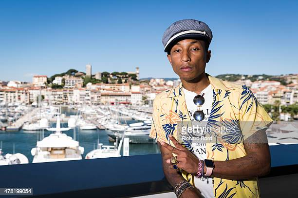 Pharrell Williams poses on the balcony of the Palais des Festivals after the iHeart Seminar during the Cannes Lions International Festival of...